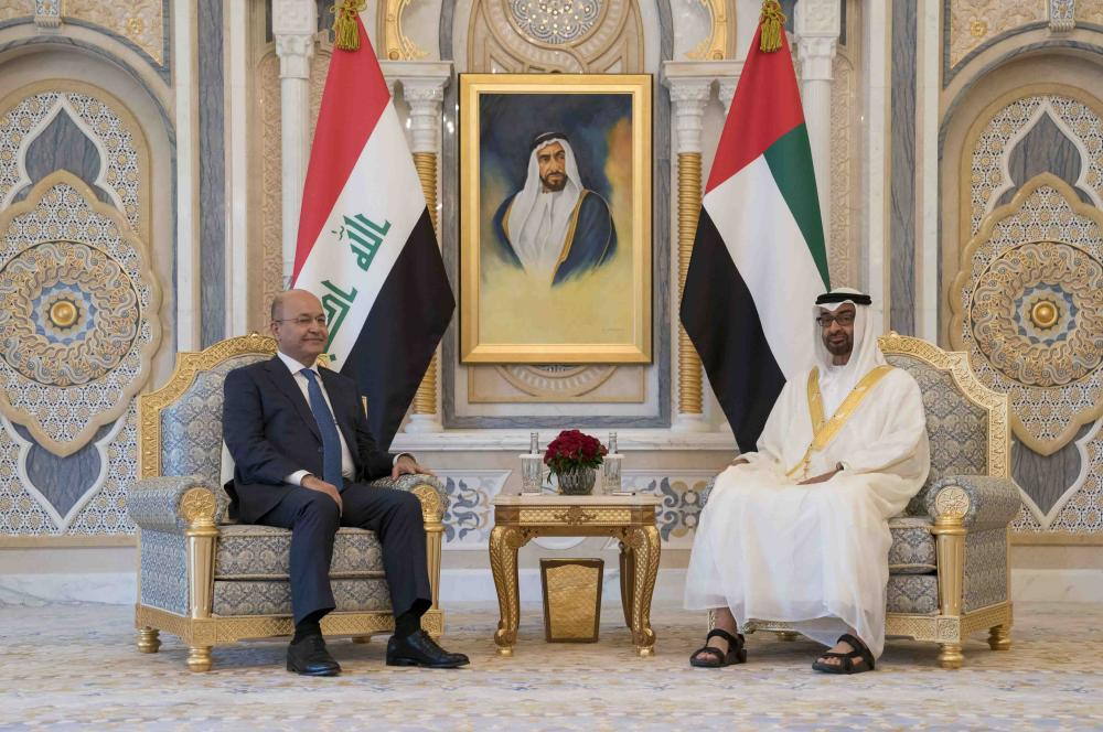 ABU DHABI, UNITED ARAB EMIRATES - November 12, 2018: HH Sheikh Mohamed bin Zayed Al Nahyan Crown Prince of Abu Dhabi Deputy Supreme Commander of the UAE Armed Forces (R), meets with HE Dr Barham Salih, President of Iraq (L), at the Presidential Palace. ( Hamad Al Kaabi / Ministry of Presidential Affairs )? ---