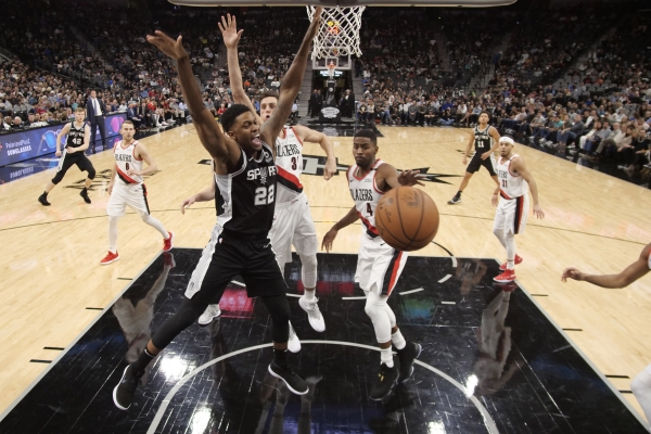 Dec 2, 2018; San Antonio, TX, USA; San Antonio Spurs small forward Rudy Gay (22) has the ball knocked away on a drive by Portland Trail Blazers small forward Maurice Harkless (4) during the second half at AT&T Center. Mandatory Credit: Soobum Im-USA TODAY Sports