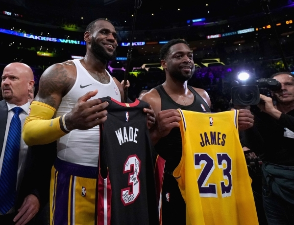 LOS ANGELES, CA - DECEMBER 10: LeBron James #23 of the Los Angeles Lakers and Dwyane Wade #3 of the Miami Heat pose for a photo after exchanging jerseys, as Wade plans to retire at the end of the season, after a 108-105 Laker win at Staples Center on December 10, 2018 in Los Angeles, California. NOTE TO USER: User expressly acknowledges and agrees that, by downloading and or using this photograph, User is consenting to the terms and conditions of the Getty Images License Agreement. Harry How/Getty Images/AFP == FOR NEWSPAPERS, INTERNET, TELCOS & TELEVISION USE ONLY ==
