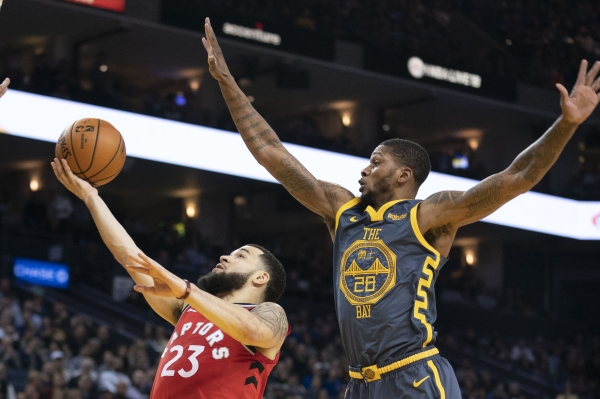 December 12, 2018; Oakland, CA, USA; Toronto Raptors guard Fred VanVleet (23) shoots the basketball against Golden State Warriors forward Alfonzo McKinnie (28) during the third quarter at Oracle Arena. Mandatory Credit: Kyle Terada-USA TODAY Sports