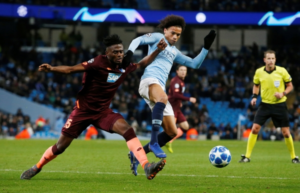 Soccer Football - Champions League - Group Stage - Group F - Manchester City v TSG 1899 Hoffenheim - Etihad Stadium, Manchester, Britain - December 12, 2018  Manchester City's Leroy Sane in action with Hoffenheim's Kasim Nuhu   REUTERS/Andrew Yates