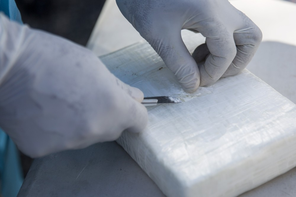 Experts make tests before the incineration of drugs at a military base in Pedro Brand, Santo Domingo province, Dominican Republic, on December 13, 2018. - Over 14 tons of drug -mainly cocaine, crack and marijuana- were incinerated since January at the military base. (Photo by Erika SANTELICES / AFP)