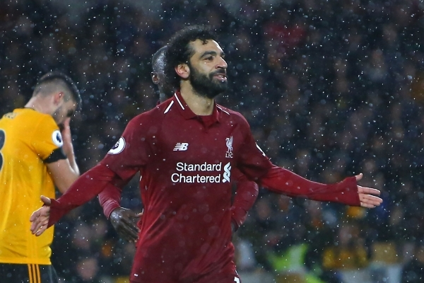 TOPSHOT - Liverpool's Egyptian midfielder Mohamed Salah celebrates after scoring the opening goal of the English Premier League football match between Wolverhampton Wanderers and Liverpool at the Molineux stadium in Wolverhampton, central England  on December 21, 2018. (Photo by Geoff CADDICK / AFP) / RESTRICTED TO EDITORIAL USE. No use with unauthorized audio, video, data, fixture lists, club/league logos or 'live' services. Online in-match use limited to 120 images. An additional 40 images may be used in extra time. No video emulation. Social media in-match use limited to 120 images. An additional 40 images may be used in extra time. No use in betting publications, games or single club/league/player publications. /