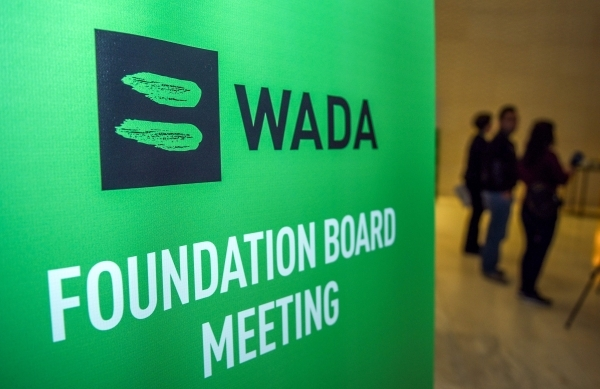 (FILES) In this file photo taken on November 15, 2018 Journalists stands in the lobby of the World Anti-Doping Agency (WADA) foundation board in Baku. - The fight against doping was put to the test in 2018. (Photo by TOFIK BABAYEV / AFP)