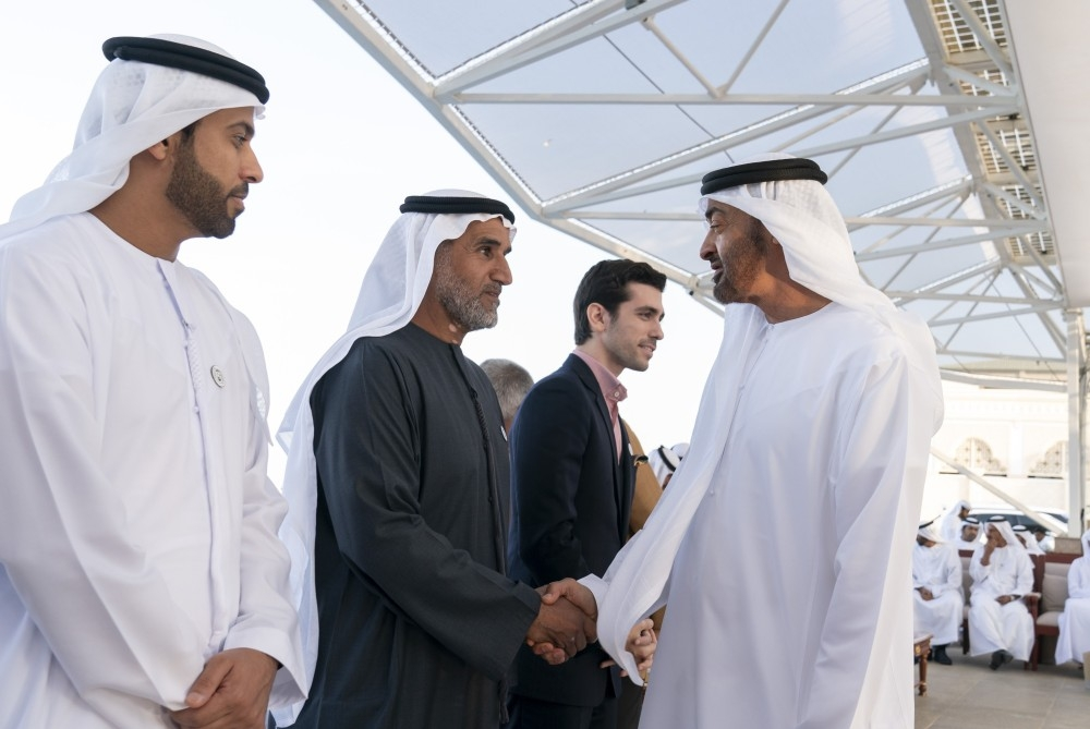 ABU DHABI, UNITED ARAB EMIRATES - December 24, 2018: HH Sheikh Mohamed bin Zayed Al Nahyan, Crown Prince of Abu Dhabi and Deputy Supreme Commander of the UAE Armed Forces (R) greets HE Khalifa Mohamed Fares Al Mazrouei, Chairman of Abu Dhabi Farmers' Services Centre (ADFSC) (2nd L), during a Sea Palace barza.  ( Mohamed Al Hammadi / Ministry of Presidential Affairs )