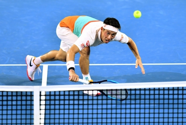 epa07259548 Kei Nishikori of Japan in action during his quarter final match against Grigor Dimitrov of Bulgaria at the Brisbane International tennis tournament at the Queensland Tennis Centre in Brisbane, Australia, 03 January 2019. EPA/DARREN ENGLAND EDITORIAL USE ONLY AUSTRALIA AND NEW ZEALAND OUT