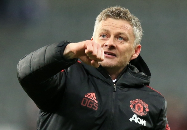 TOPSHOT - Manchester United's Norwegian caretaker manager Ole Gunnar Solskjaer celebrates following the English Premier League football match between Newcastle United and Manchester United at St James' Park in Newcastle-upon-Tyne, north east England on January 2, 2019. - Manchester United won the match 2-0. (Photo by Lindsey PARNABY / AFP) / RESTRICTED TO EDITORIAL USE. No use with unauthorized audio, video, data, fixture lists, club/league logos or 'live' services. Online in-match use limited to 120 images. An additional 40 images may be used in extra time. No video emulation. Social media in-match use limited to 120 images. An additional 40 images may be used in extra time. No use in betting publications, games or single club/league/player publications. /
