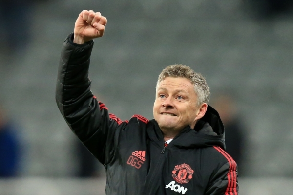 Manchester United's Norwegian caretaker manager Ole Gunnar Solskjaer applauds the fans following the English Premier League football match between Newcastle United and Manchester United at St James' Park in Newcastle-upon-Tyne, north east England on January 2, 2019. - Manchester United won the match 2-0. (Photo by Lindsey PARNABY / AFP) / RESTRICTED TO EDITORIAL USE. No use with unauthorized audio, video, data, fixture lists, club/league logos or 'live' services. Online in-match use limited to 120 images. An additional 40 images may be used in extra time. No video emulation. Social media in-match use limited to 120 images. An additional 40 images may be used in extra time. No use in betting publications, games or single club/league/player publications. /