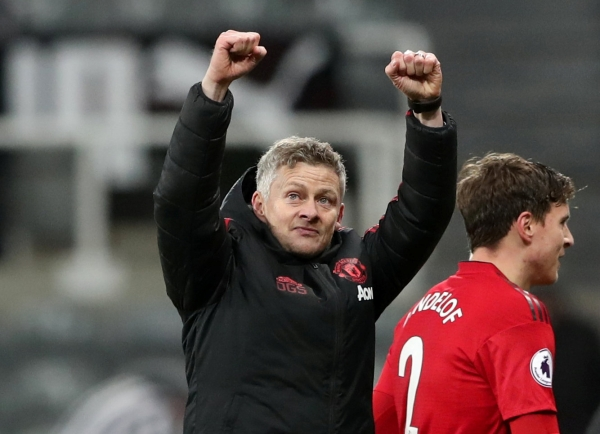 """Soccer Football - Premier League - Newcastle United v Manchester United - St James' Park, Newcastle, Britain - January 2, 2019 Manchester United interim manager Ole Gunnar Solskjaer celebrates at the end of the match REUTERS/Scott Heppell EDITORIAL USE ONLY. No use with unauthorized audio, video, data, fixture lists, club/league logos or """"live"""" services. Online in-match use limited to 75 images, no video emulation. No use in betting, games or single club/league/player publications. Please contact your account representative for further details."""