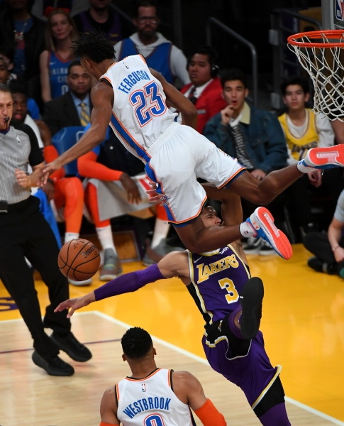 Jan 2, 2019; Los Angeles, CA, USA; Oklahoma City Thunder guard Terrance Ferguson (23) flips over Los Angeles Lakers guard Josh Hart (3) as he leaps to block a shot in the second half of the game at Staples Center. Mandatory Credit: Jayne Kamin-Oncea-USA TODAY Sports