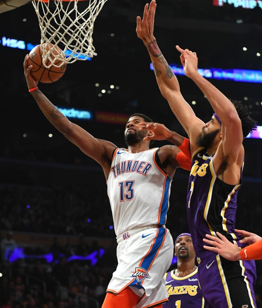 Jan 2, 2019; Los Angeles, CA, USA;Los Angeles Lakers center JaVale McGee (7) defends Oklahoma City Thunder forward Paul George (13) as he goes for a layup in the first half of the game at Staples Center. Mandatory Credit: Jayne Kamin-Oncea-USA TODAY Sports