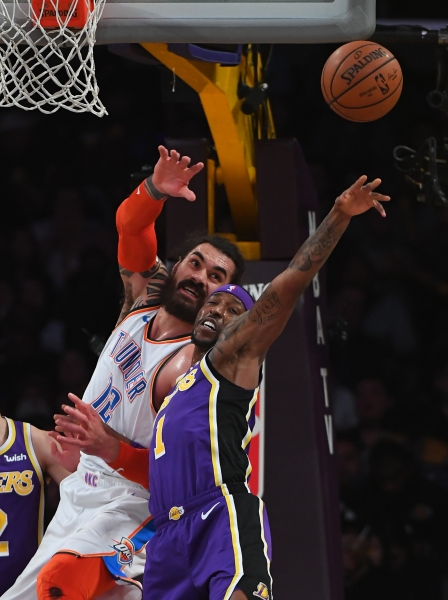 Jan 2, 2019; Los Angeles, CA, USA; Los Angeles Lakers guard Kentavious Caldwell-Pope (1) blocks a pass for Oklahoma City Thunder center Steven Adams (12) in the second half of the game at Staples Center. Mandatory Credit: Jayne Kamin-Oncea-USA TODAY Sports