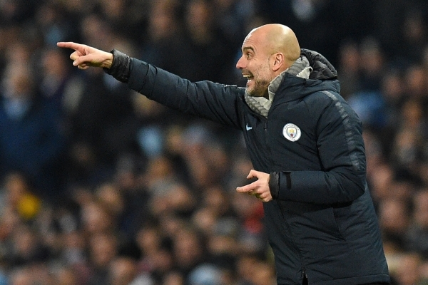 Manchester City's Spanish manager Pep Guardiola gestures on the touchline during the English Premier League football match between Manchester City and Liverpool at the Etihad Stadium in Manchester, north west England, on January 3, 2019. (Photo by Oli SCARFF / AFP) / RESTRICTED TO EDITORIAL USE. No use with unauthorized audio, video, data, fixture lists, club/league logos or 'live' services. Online in-match use limited to 120 images. An additional 40 images may be used in extra time. No video emulation. Social media in-match use limited to 120 images. An additional 40 images may be used in extra time. No use in betting publications, games or single club/league/player publications. /