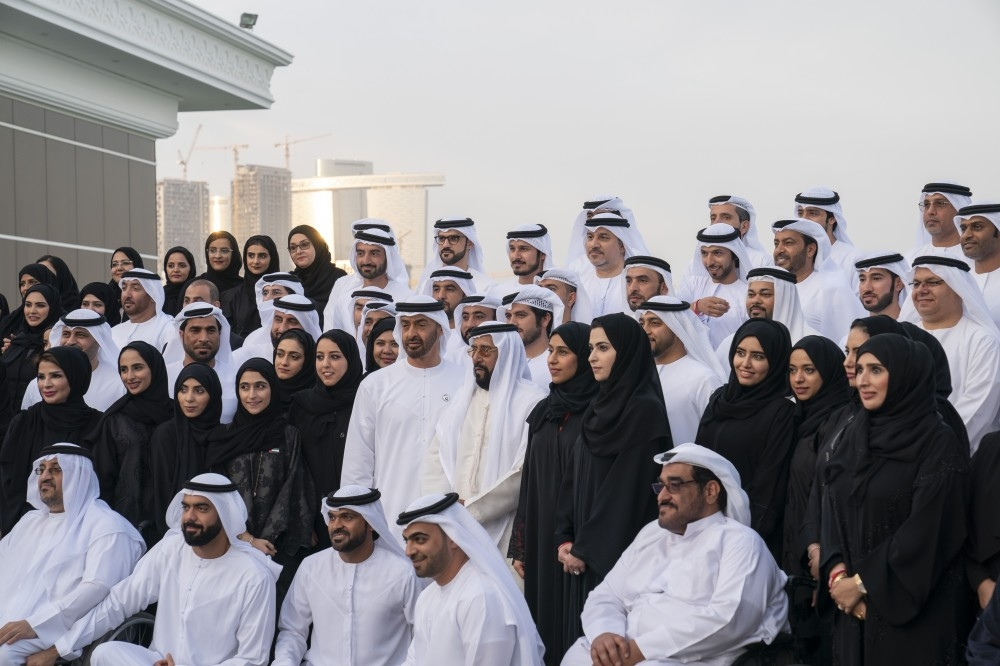 ABU DHABI, UNITED ARAB EMIRATES - January 07, 2019: HH Sheikh Mohamed bin Zayed Al Nahyan, Crown Prince of Abu Dhabi and Deputy Supreme Commander of the UAE Armed Forces (2nd row 6th L), stands for a photograph with members of the Host Town committees of the Special Olympics World Games Abu Dhabi 2019, at the Sea Palace barza. Seen with HH Sheikh Tahnoon bin Mohamed Al Nahyan, Ruler's Representative in Al Ain Region (2nd row 7th L), and HE Saif Ghobash, Director General of Abu Dhabi Tourism and Culture Authority (front row 2nd L). ( Mohamed Al Hammadi / Ministry of Presidential Affairs ) ---