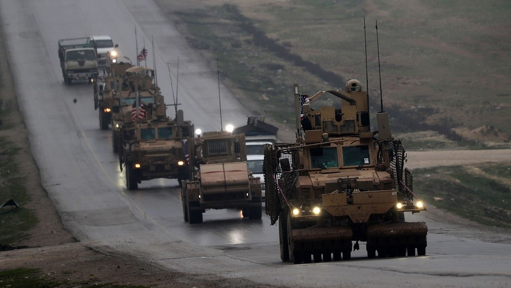 (FILES) In this file photo taken on December 30, 2018 a convoy of US military vehicles rides in Syria's northern city of Manbij. - The US-led military coalition in Syria has begun pulling out troops, a spokesman said on January 11, 2019 without elaborating on locations or timetables.
