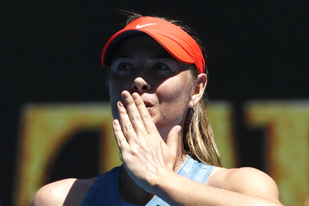 Tennis - Australian Open - First Round - Rod Laver Arena, Melbourne, Australia, January 14, 2019. Russia's Maria Sharapova reacts at her match against Britain's Harriet Dart. REUTERS/Kim Kyung-Hoon