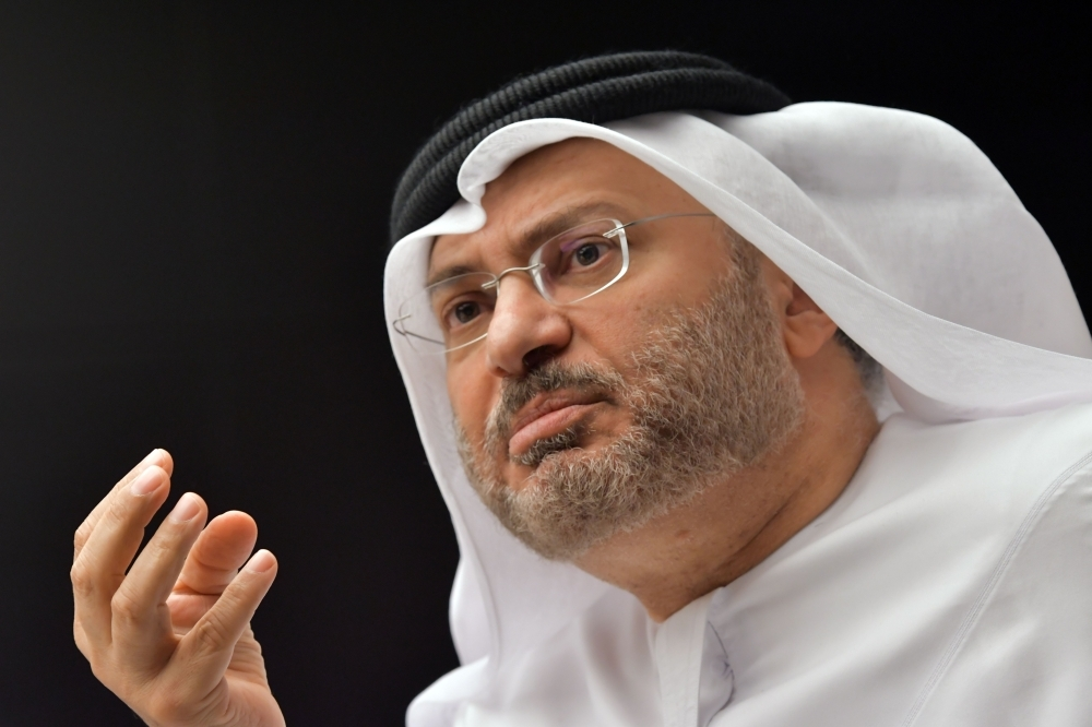 UAE state minister for foreign affairs, Anwar Gargash, speaks during a press conference at his office in Dubai on June 24, 2017. / AFP PHOTO / GIUSEPPE CACACE