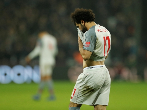 """Soccer Football - Premier League - West Ham United v Liverpool - London Stadium, London, Britain - February 4, 2019 Liverpool's Mohamed Salah reacts after the match Action Images via Reuters/John Sibley EDITORIAL USE ONLY. No use with unauthorized audio, video, data, fixture lists, club/league logos or """"live"""" services. Online in-match use limited to 75 images, no video emulation. No use in betting, games or single club/league/player publications. Please contact your account representative for further details."""