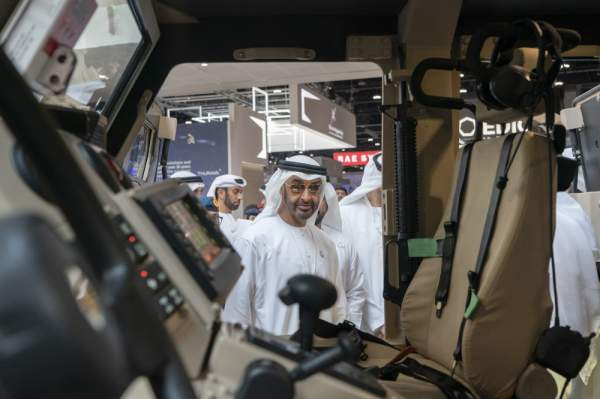 ABU DHABI, UNITED ARAB EMIRATES - February 20, 2019: HH Sheikh Mohamed bin Zayed Al Nahyan, Crown Prince of Abu Dhabi and Deputy Supreme Commander of the UAE Armed Forces (C) tours the International Defence Exhibition and Conference (IDEX), at Abu Dhabi National Exhibition Centre (ADNEC).   ( Rashed Al Mansoori / Ministry of Presidential Affairs ) ---