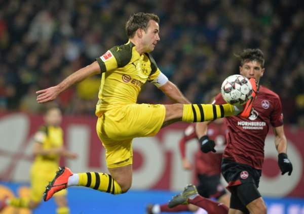 Dortmund's German midfielder Mario Goetze plays the ball during the German first division Bundesliga match between 1 FC Nuremberg and Borussia Dortmund in Nuremberg, southern Germany, on February 18, 2019. (Photo by TIMM SCHAMBERGER / AFP) / DFL REGULATIONS PROHIBIT ANY USE OF PHOTOGRAPHS AS IMAGE SEQUENCES AND/OR QUASI-VIDEO