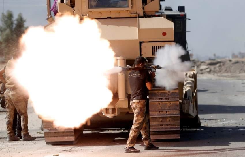 مقاتل من كائب حزب الله العراقي. (رويترز)