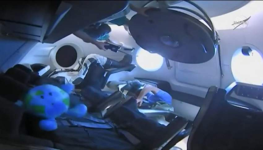 """This video grab taken from the Space X webcast transmission on March 3, 2019, shows a dummy named Ripley onboard a SpaceX Falcon 9 rocket with the company's Crew Dragon spacecraft onboard after the opening of the hatch during the Demo-1 mission. (Photo by HO / SPACEX / AFP) / RESTRICTED TO EDITORIAL USE - MANDATORY CREDIT """"AFP PHOTO / SPACEX"""" - NO MARKETING NO ADVERTISING CAMPAIGNS - DISTRIBUTED AS A SERVICE TO CLIENTS ---"""