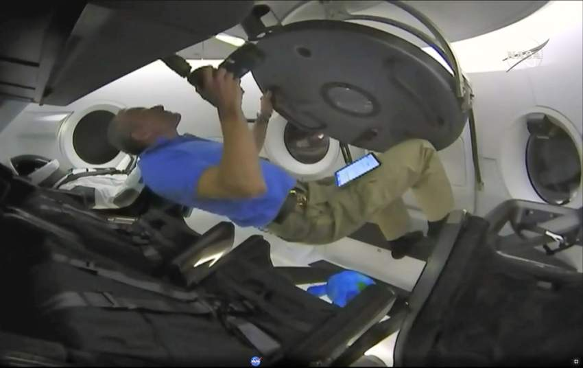 epa07411241 A handout still photo grabbed off NASA TV video showing CSA astronaut David Saint-Jacques taking a look inside the SpaceX Dragon capsule carrying a instrumented dummy (L) after it succesfully docked with Space Station as part of the Demo-1 mission, 03 March 2019. The Demo-1 mission will be the first launch of a commercially built and operated American spacecraft and space system designed for humans as part of NASA's Commercial Crew Program. The mission serves as an end-to-end test of the system's capabilities. EPA/NASA TV / HANDOUT MANDATORY CREDIT: NASA TV HANDOUT EDITORIAL USE ONLY