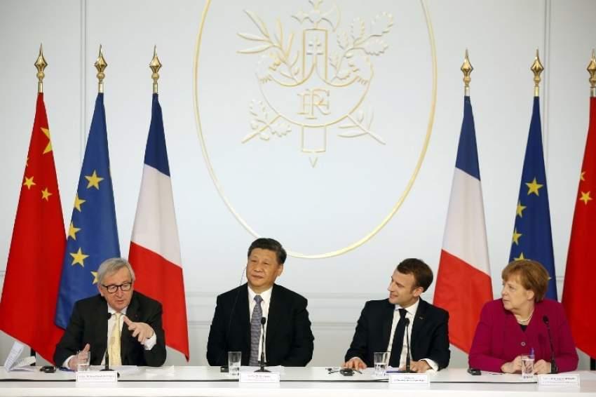 ماكرون يستقبل شي وميركل ويونكر في باريس لبحث التعاون متعدد الأطراف