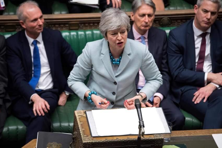 تيريزا ماي متحدثة أمام البرلمان البريطاني أمس الأول. (أ ف ب)