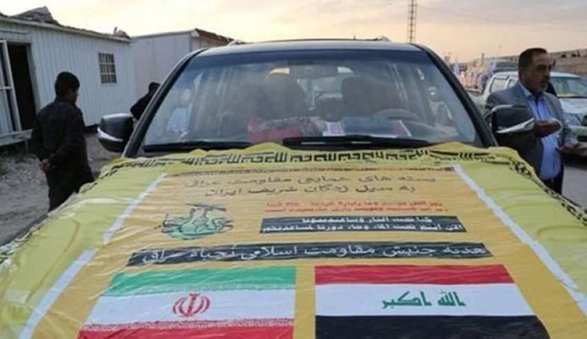 قافلة مساعدات ميليشيات «النجباء» لدى وصولها إلى إيران. (الرؤية)