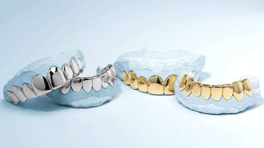 طقم أسنان من البلاتين النقي وذهب من عيار 18 الذهب