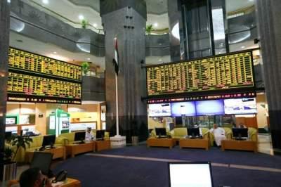 سوق أبوظبي للأوراق المالية يبحث التعاون مع بورصة لندن