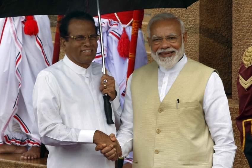 رئيس سريلانكا مستقبلاً ناريندرا مودي. (إي بي إيه)