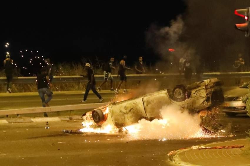 الشرطة الاسرائيلية تشتبك مع المحتجين. أ ف ب