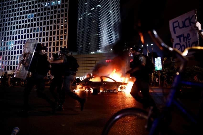 جانب من الاحتجاجات في تل ابيب. رويترز