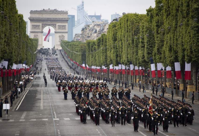epa07716192 A general view of troops marching during the annual Bastille Day military parade on the Champs Elysees avenue in Paris, France, 14 July 2019. Bastille Day, the French National Day, is held annually on 14 July to commemorate the storming of the Bastille fortress in 1789. EPA/IAN LANGSDON