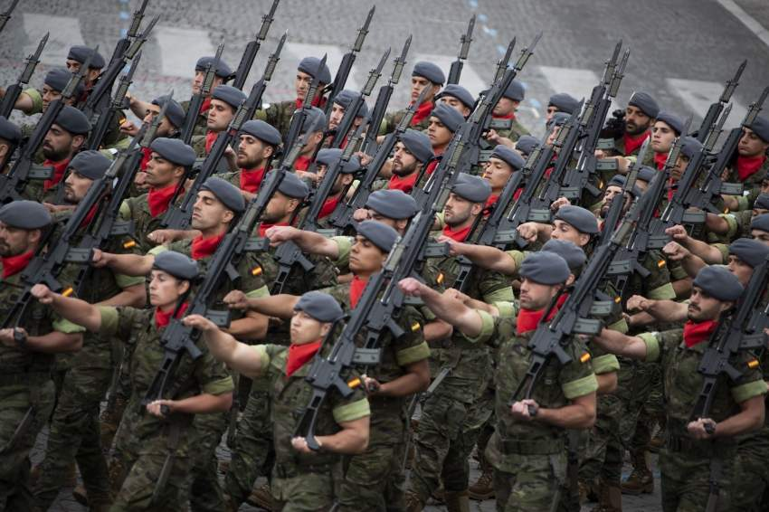 epa07716193 Spanish troops march during the annual Bastille Day military parade on the Champs Elysees avenue in Paris, France, 14 July 2019. Bastille Day, the French National Day, is held annually on 14 July to commemorate the storming of the Bastille fortress in 1789. EPA/IAN LANGSDON