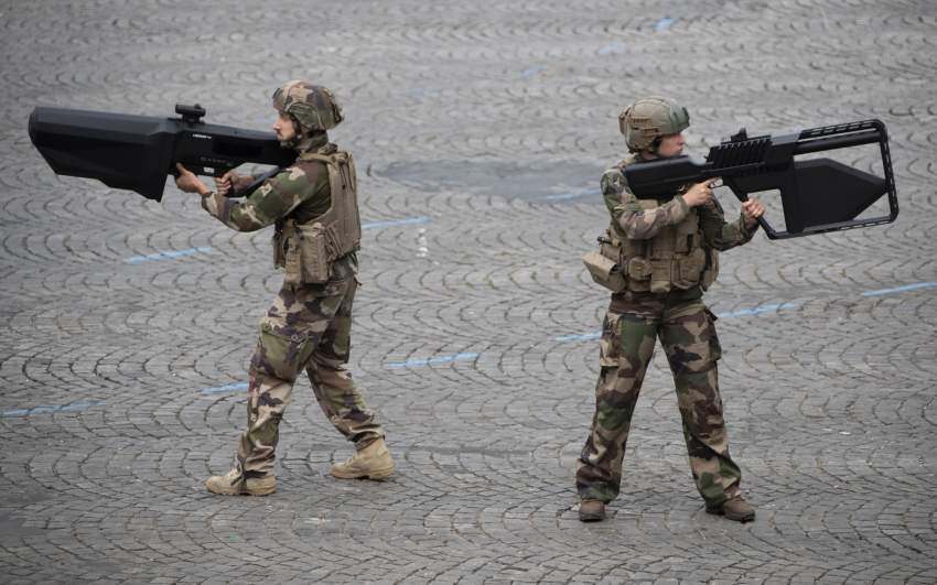 epa07716155 French soldiers demonstrate NEROD F5 anti-drone rifles during the annual Bastille Day military parade on the Champs Elysees avenue in Paris, France, 14 July 2019. Bastille Day, the French National Day, is held annually on 14 July to commemorate the storming of the Bastille fortress in 1789. EPA/IAN LANGSDON