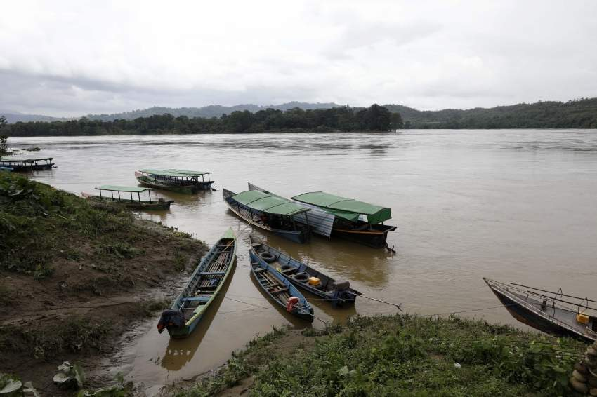 epa07717218 Boats stop near the Myitsone area of Ayeyarwaddy river at Ayeyarwaddy Myitsone, near the Myitsone dam project, Myitkyina, Kachin State, 14 July 2019. The Myitsone Dam project began in 2009, when Myanmar was still under the rule of a junta. It was initially scheduled to be completed in 2017. China Power Investment Corporation (CPI), the contractor, had designed the dam to be the world's fifteenth largest hydroelectric power station, producing up to 6,000 megawatts of electricity. 90 percent of that power was to be exported to neighboring Yunnan province in south-west China. The dam, sitting on the Irrawaddy, Myanmar's longest river, was fiercely opposed by the Kachin Independence Organization (KIO), an armed insurgency that has been fighting for the partial autonomy of the Kachin state for the past five decades. In 2011, former Myanmar president Thein Sein announced that the project was to be suspended due to protests from locals and environmentalists. EPA/NYEIN CHAN NAING