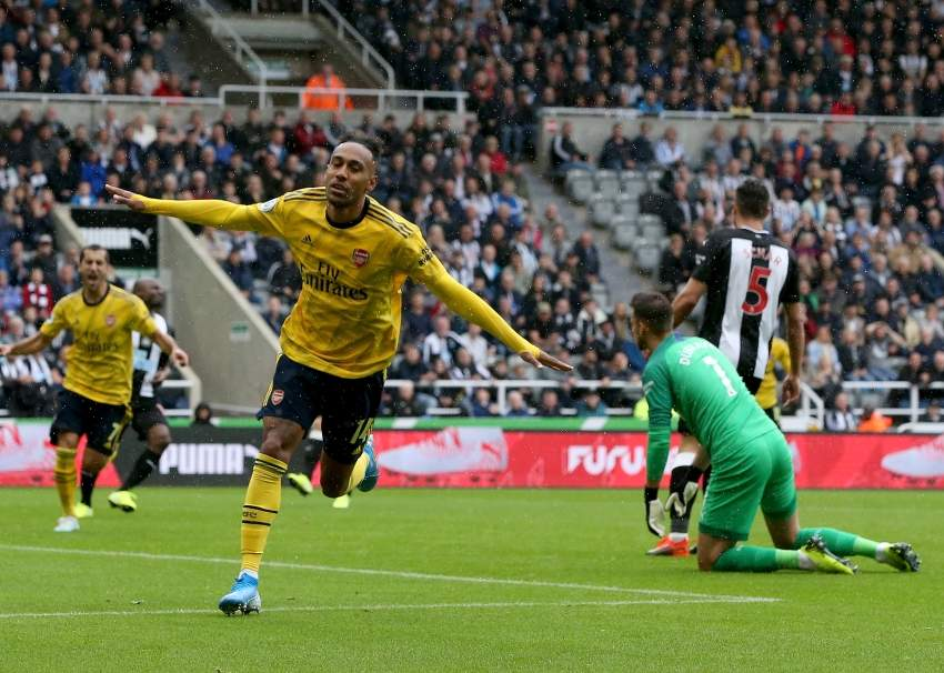 epa07768489 Arsenal's Pierre-Emerick Aubameyang (L) celebrates scoring during the English Premier League soccer match between Newcastle United and Arsenal at St James Park Stadium in Newcastle, Britain, 11 August 2019. EPA/NIGEL RODDIS EDITORIAL USE ONLY. No use with unauthorized audio, video, data, fixture lists, club/league logos or 'live' services. Online in-match use limited to 120 images, no video emulation. No use in betting, games or single club/league/player publications
