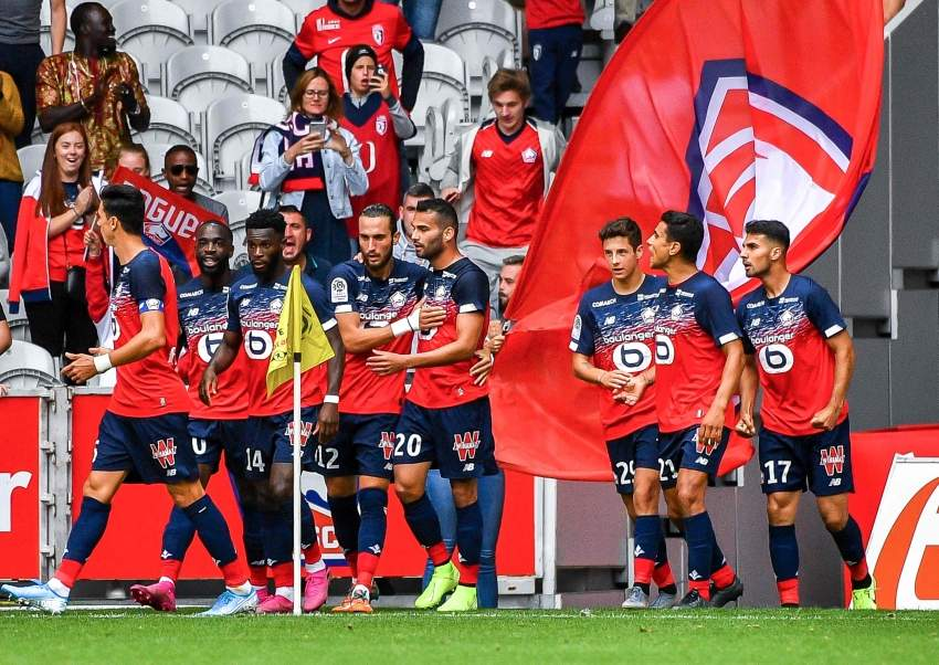 Lille's Nigerian forward Victor Osimhen is congratulated by his teammates after scoring a second goal during the French L1 football match between Lille (LOSC) and FC Nantes at the Pierre Mauroy Stadium in Villeneuve-d'Ascq northern France, on August 11, 2019. (Photo by PHILIPPE HUGUEN / AFP)
