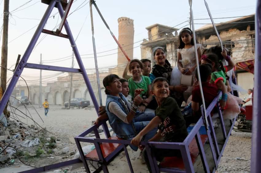 بهجة العيد عند أطفال العراق (رويترز)