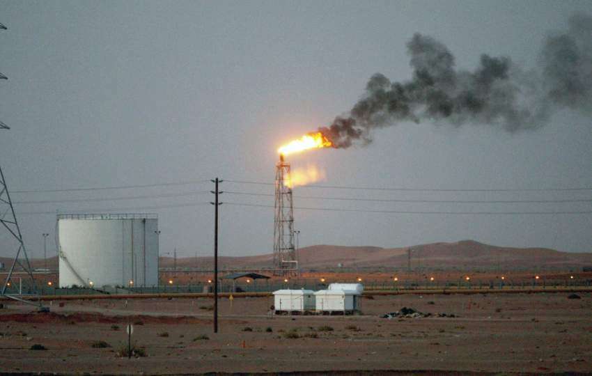 epa07769472 (FILE) - An image showing a gas flame behind pipelines in the desert at Khurais oil field, about 160 km from Riyadh, Kingdom of Saudi Arabia, 23 June 2008 (reissued 12 August 2019). Saudi Arabia's national petroleum and natural gas company Saudi Aramco on 12 August 2019 reported earnings of 47 billion US dollars for the first half of 2019.  EPA/ALI HAIDER *** Local Caption *** 55191232