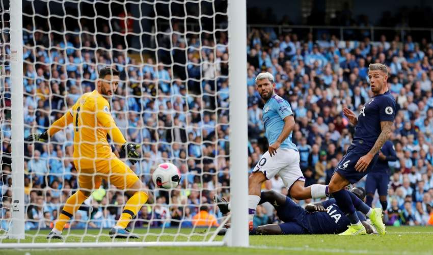 Soccer Football - Premier League - Manchester City v Tottenham Hotspur - Etihad Stadium, Manchester, Britain - August 17, 2019  Manchester City's Sergio Aguero scores their second goal   REUTERS/Phil Noble  EDITORIAL USE ONLY. No use with unauthorized audio, video, data, fixture lists, club/league logos or