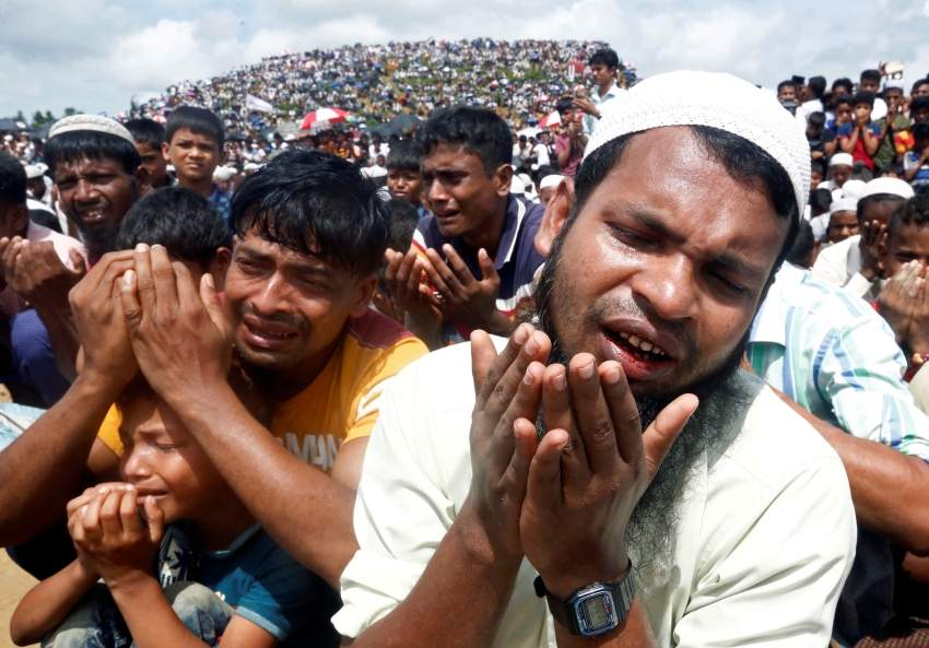 FILE PHOTO: Rohingya refugees take part in a prayer as they gather to mark the second anniversary of the exodus at the Kutupalong camp in Cox's Bazar, Bangladesh, August 25, 2019. REUTERS/Rafiqur Rahman/File Photo