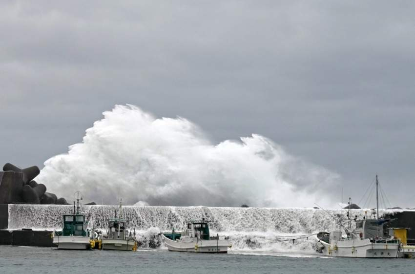 epa07912750 Surging waves generated by typhoon Hagibis hit against a breakwater at a port in the town of Kiho, Mie Prefecture, Japan, 11 October 2019. Powerful typhoon Hagibis is expected to hit central Japan and Tokyo area, disrupting transports and major sports events such as the Formula One Grand Prix of Japan and the Rugby World Cup. EPA/FRANCK ROBICHON