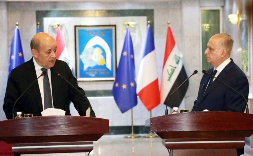 مؤتمر صحفي لوزيري خارجية العراق وفرنسا في بغداد الخميس. (إي بي أيه)