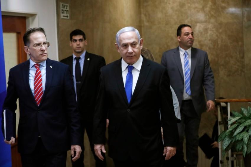 نتانياهو لدى وصوله لحضور الاجتماعي الاسبوعي للحكومة (أ ف ب)