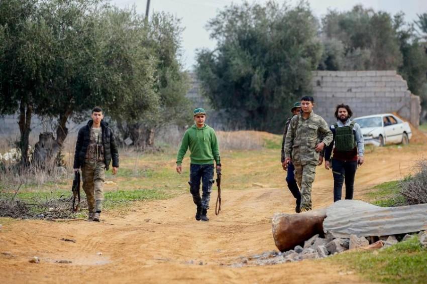 عناصر تابعة للميليشيات جنوب العاصمة طرابلس (أ ف ب)