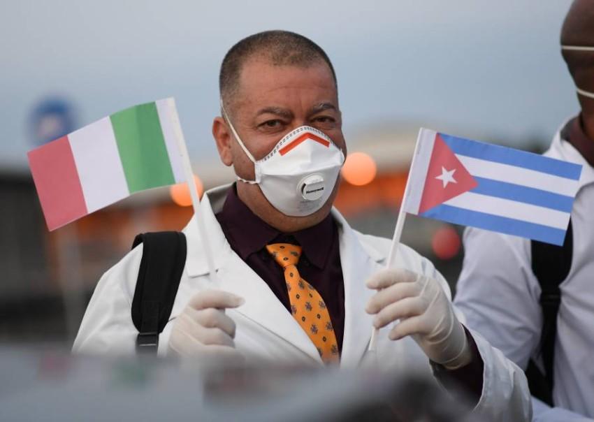 الوفد الطبي الكوبي يصل ايطاليا للتضامن ومكافحة كورونا - رويترز